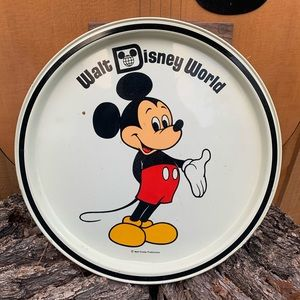 Vintage Mickey Mouse metal plate.